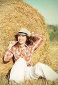 Beautiful Happy Woman Near Haystack In The Sunny Field