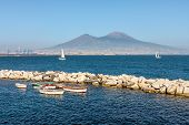 Boats at anchor on a background of Vesuvius