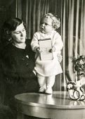 GERMANY, OCTOBER 11, 1938: Vintage photo of mother with her little daughter
