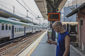 Man Waits At The Train Station
