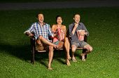 image of watching movie  - three friends watching a movie at cinema outdoors - JPG