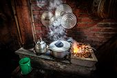 stock photo of kettles  - Street kitchen with kettle on open fire in Vietnam - JPG