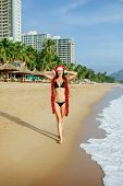 Santa Girl Making Wish On The Beach In Tropics