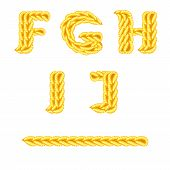 Yellow knitted alphabet F - J