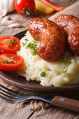 Appetizing Sausages With Mashed Potatoes Close-up. Vertical