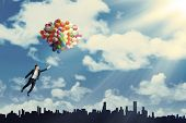 Woman Flying With Balloons To Get Her Dream
