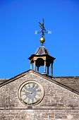 Clock and weathervane on Tissington Hall.