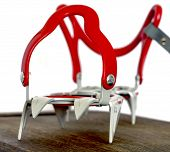 Grey alpine climbing crampons close up image