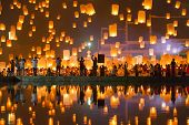 CHIANG MAI, THAILAND - NOVEMBER 8, 2014: People release Khom Loi, the sky lanterns during Yi Peng or Loi Krathong festival on November 8, 2014 in Mae Jo University, Chiang Mai, Thailand.