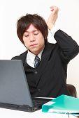 businessman suffers from headache