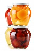 Jars With Fruity Compotes Isolated On White. Preserved Fruits