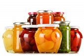 Jars With Fruity Compotes And Jams Isolated On White