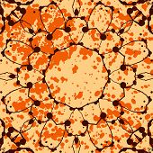 Orange background with splattered paint and watercolor mandala flower.