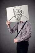 Businessman holding a cardboard with a smoking man on it in front of his head