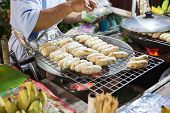 pic of charcoal  - thailand traditional snack roasted banana on charcoal stove  - JPG