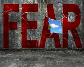 Red Fear Word On Grey Grunge Concrete Wall