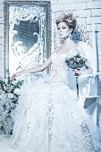 stock photo of snow queen  - Beautiful girl in white dress in the image of the Snow Queen with a crown on her head - JPG
