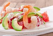 California salad - a mix of avocado, grapefruit and shrimp, seasoned with cayenne pepper yogurt
