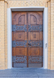 stock photo of stanislaus church  - Decorated door of side entrance of Cathedral Basilica of Saint Stanislaus Kostka  - JPG