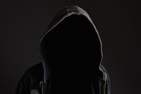 foto of incognito  - Faceless unknown and unrecognizable man without identity wearing hood in dark room spooky criminal person - JPG