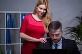 stock photo of inappropriate  - Young pretty woman touching inappropriate her employer - JPG