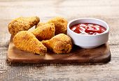 image of southern fried chicken  - a fried chicken on a wooden board - JPG