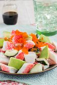 foto of masago  - Deconstructed California roll poke made with imitation crab cucumber avocado and capelin roe - JPG