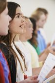 stock photo of 11 year old  - Group Of School Children Singing In Choir Together