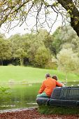 stock photo of retirement age  - Rear view of aged couple enjoying retirement - JPG