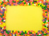 stock photo of jelly beans  - Frame and background made of colorful jelly beans - JPG