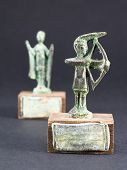 pic of figurines  - archer bronze statuette and chieftain praying with cloak and stick figurine - JPG