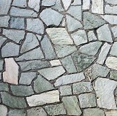 foto of tile cladding  - section of flagstone wall with varying shapes and lines - JPG