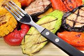 stock photo of sweet-corn  - Fork and Grilled Vegetables Assortment On The Wood Cutting Board - JPG