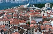 picture of upside  - The view over red tiles roofs of the old center of Kotor Montenegro and the bay from the ancient fortress wall upside the mountain - JPG