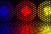 pic of diodes  - Three bright LED lights are behind a lattice - JPG