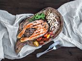 picture of salmon steak  - Grilled salmon steak with fresh herbs roasted mushrooms cherry - JPG