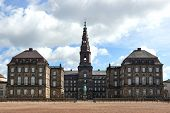 picture of copenhagen  - Christiansborg Palace in Copenhagen Denmark with clouds and blue skies in the background - JPG