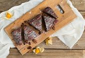 picture of ground nut  - Pecan brownie cake with ground cherry on a wooden board