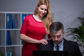 foto of inappropriate  - Young pretty woman touching inappropriate her employer - JPG