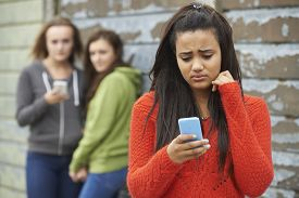 image of gang  - Teenage Girl Being Bullied By Text Message - JPG