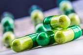 Pills. Tablets. Capsule. Heap of pills. Medical background. Close-up of pile of yellow green tablets poster