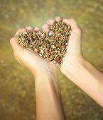 Heart symbol in feminine hand. Conceptual design.