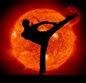 Martial art. Karate man and Sun planet.