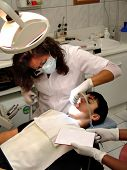Teenager boy having his cavities fixed by a dentist