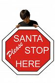 Young man, holding a Santa stop sign