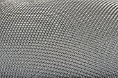 Actually, this is a macro of a circular stainless steel mesh, the rhombic shapes creating unique textures and deep of field perspective