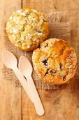picture of bakeshop  - bluberry and poppy seed muffins in rustic style - JPG