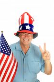 A handsome patriotic man wears an American Flag Hat, holds an American Flag and gives the Peace sign poster