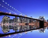 stock photo of brooklyn bridge  - Brooklyn Bridge and Manhattan skyline At Night - JPG