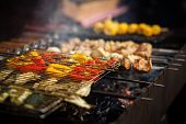 Delicious Vegetables Grilling On Open Grill, Outdoor Kitchen. Food Festival In City. Tasty Food Pepp poster